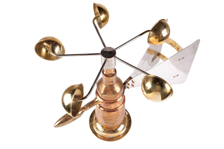 Midcentury Ship's Anemometer in brass with an aluminum fin. These were used outside on ships to measure wind speed and direction connected to a corresponding gauge on the bridge. This has great sculptural form and a rare find. The brass base has