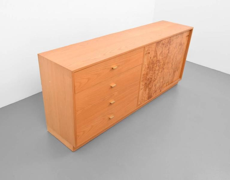 Burl wood credenza by Harvey Probber.  Cabinet has four drawers and two doors revealing two adjustable shelves.