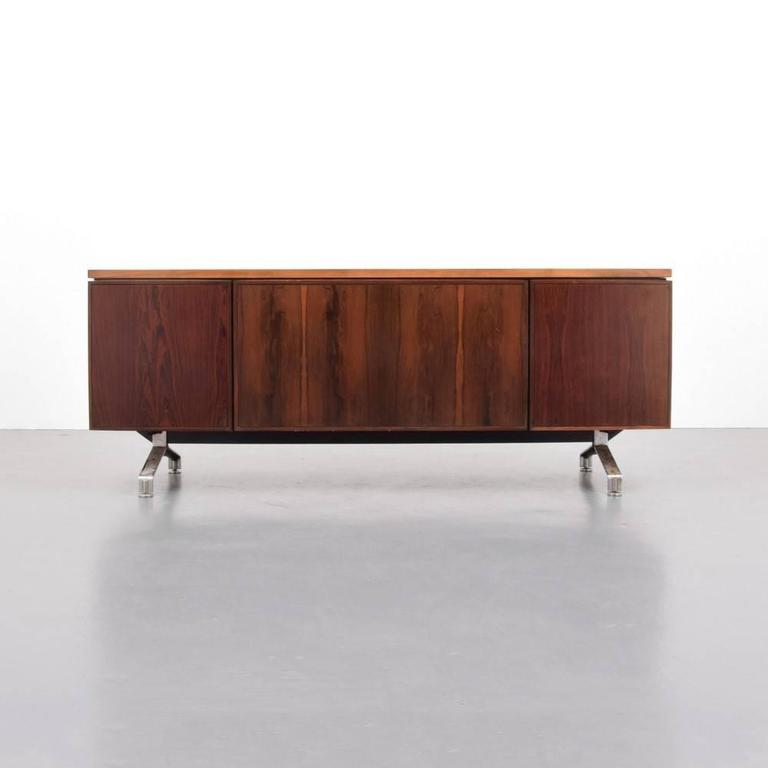 Beautiful rosewood credenza with chrome accents by Imperial Desk Company.  Matching desk available for $4495