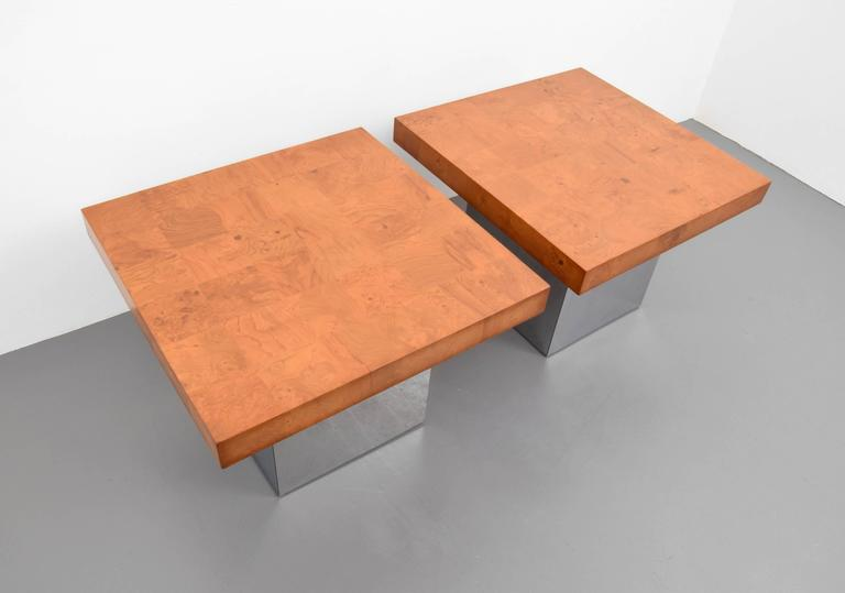 Gorgeous pair Milo Baughman burl wood and chrome end tables. Wood is in excellent shape and chrome is in very good vintage condition.