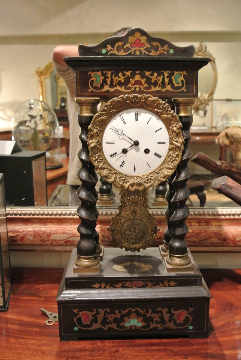French Empire style brass inlaid portico clock, circa 1880. Recently restored.