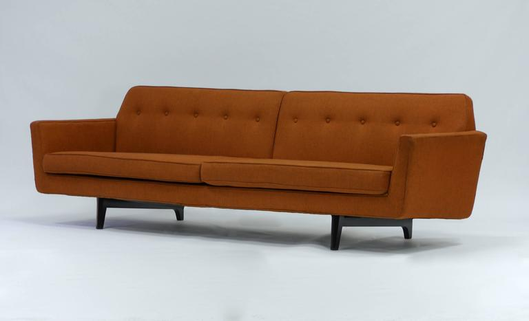 Pair of bracket back sofas by Edward Wormley for Dunbar. Original upholstery and wood elements have been refinished.