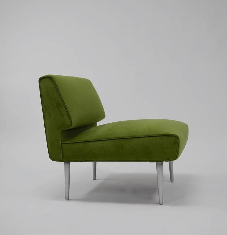Pair of lounge chairs by Edward Wormley for Dunbar. An early but futuristic design from Wormley, this chairs dates from 1948. Fully restored / reupholstered in high quality smoked green velvet.