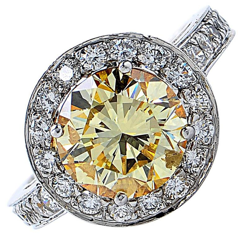 3.36 Carat GIA Graded Fancy Yellow Diamond Platinum Engagement Ring