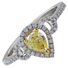 .48 Carat GIA Graded Fancy Yellow Diamond Halo Engagement Ring