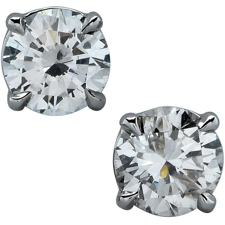 1.23 Carat Diamond Solitaire Stud Earrings For Sale