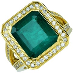 GIA Graded 8.15 Carat Emerald with Diamond Halo