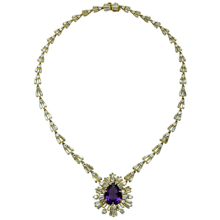 18K Yellow gold necklace showcasing an 8.6ct pear shape purple amethyst, surrounded by 162 Baguette shape diamonds weighing approximately 10cts and 52 round brilliant cut diamonds weighing approximately 5.50cts, K color, VS-SI clarity. This necklace