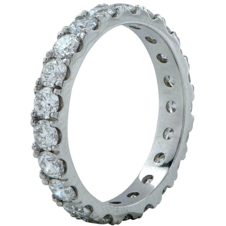 This handmade platinum wedding band contains 22 round brilliant cut diamonds weighing 1.43cts G-H color and VS-SI clarity. Exuding simplicity and elegance this multi functional ring is a size 4, and can be produced in any size.  Our pieces are all