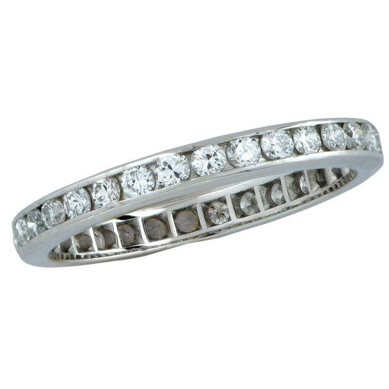 Platinum eternity band size 6. Featuring 33 round brilliant cut diamonds weighing approximately .80cts total, G color SI clarity.  Our pieces are all accompanied by an appraisal performed by one of our in-house GIA Graduates. They are also