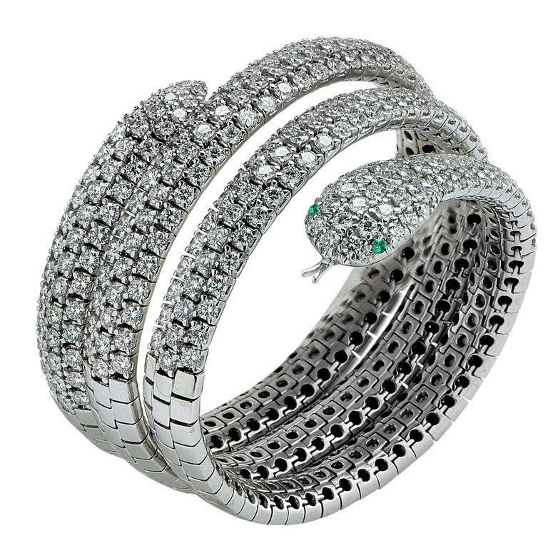 Feast your senses on this superbly crafted 18k white gold snake bangle adorned with round brilliant cut diamonds weighing approximately 24cts total, G color VS clarity. This superb bracelet glides over your wrist and envelopes it in silky smooth