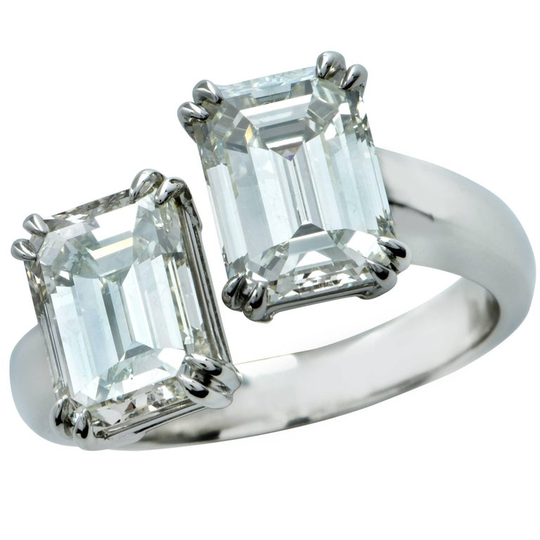 4.02 Carat Emerald Cut Diamond Platinum Bypass Ring For Sale