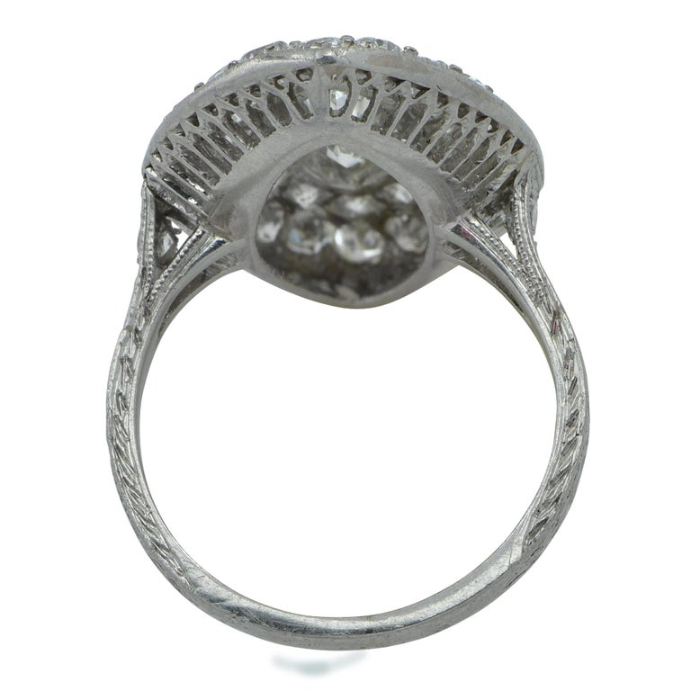Stunning vintage art deco platinum ring featuring 2.24 carats total weight of diamonds. The focal point of this gorgeous ring is a G.I.A Certified vintage marquise cut diamond weighing 1.04 carats, H color, SI1 clarity, surrounded by a row of 24