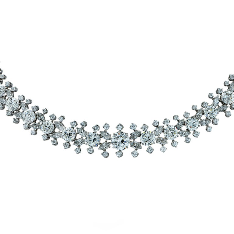 From the legendary house of Harry Winston, this exquisite necklace, expertly crafted in fine platinum by the renowned French jeweler, Francois Tavernier, showcases 52 carats total weight of collection diamonds set in a stunning floral design. This