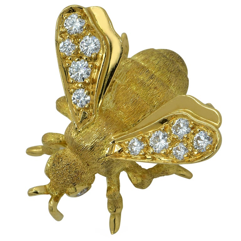 Enchanting Bee brooch pin crafted in 18k Yellow Gold, showcasing 2 round brilliant cut diamond eyes, and wings adorned with 10 round brilliant cut diamonds. The diamond weight is approximately .40cts total G color VS clarity. This beautiful brooch