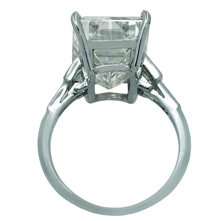 Simply stunning engagement ring crafted in platinum showcasing a stunning emerald cut diamond weighing an impressive 12.84 carats, Y-Z color GIA, VVS clarity. The band of the ring is adorned with 6 baguettes weighing .60 carats, I-J color, VS