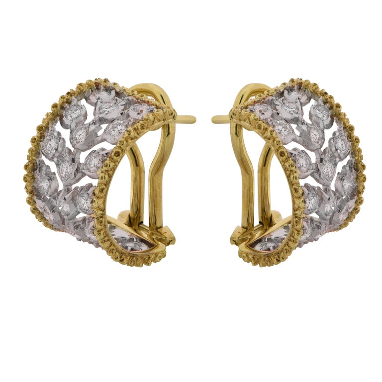 Spectacular three row diamond huggie earrings from the Ramage Collection by Buccellati, crafted in 18 Karat white and yellow gold, featuring forty round brilliant cut diamonds weighing approximately  .80 carats, E-F color, VVS clarity. These