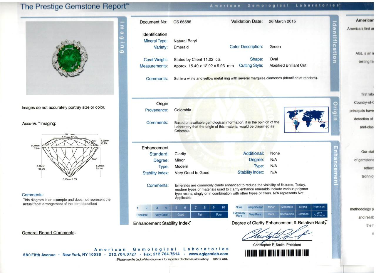 This Impressive 11.02 Carat AGL Certified Colombian Emerald is surrounded by 23 Marquise Cut Diamonds with an Estimated Total Weight of 2.25cts set in Platinum. Ring Size: 6.5.
