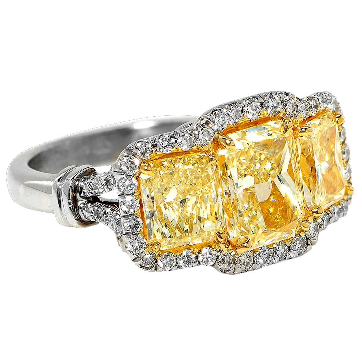 Platinum 5ct Fancy Yellow Diamond Ring Featuring Three Fancy Yellow Diamonds with an Estimated Total Weight of 4ct and 52 Round Brilliant Cut Diamonds with an Estimated Weight of 1ct.