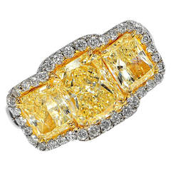 5 Carat Fancy Yellow Diamond Platinum Three-Stone Ring