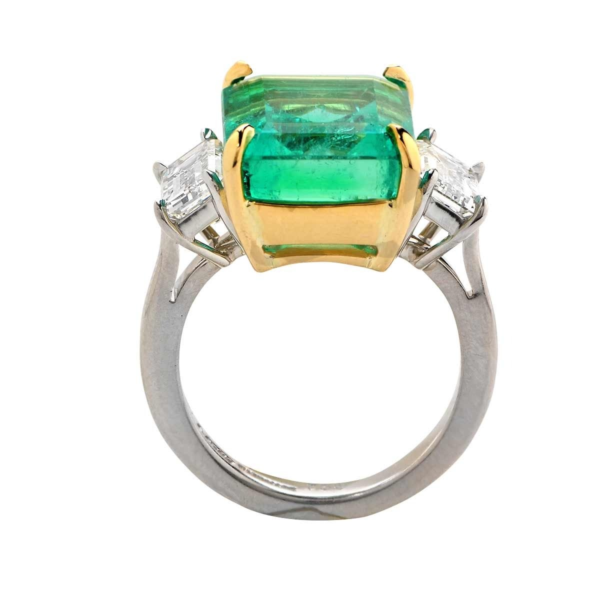 Platinum handmade ring featuring an AGL graded 9.84ct Colombian emerald flanked by two GIA graded emerald cut diamonds weighing 2.08cts total, H-I color, VVS2-VS2 clarity.  The ring is a size 6.25 and can be sized up or down. It is stamped and/or
