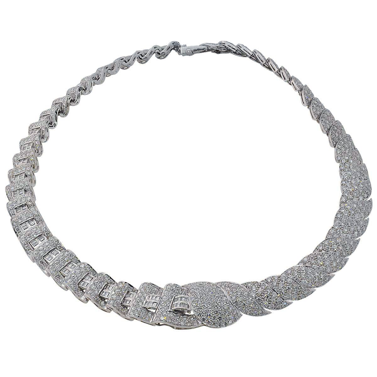 Exquisite Lady's Platinum Diamond Necklace with 1486 Mix Cut Diamonds Weighing Approximately 32.5cts Adorn this Beautiful Example of Modern Day Precise Craftsmanship. The Bow Which Features a One Carat Emerald Cut Diamond can be Removed and Worn as