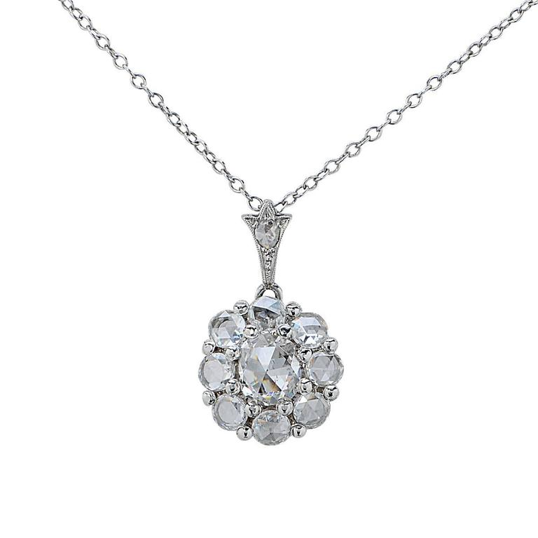 Platinum Pendant Set with 9 Rose Cut Diamonds Weighing Approximately 2.25 Carats.