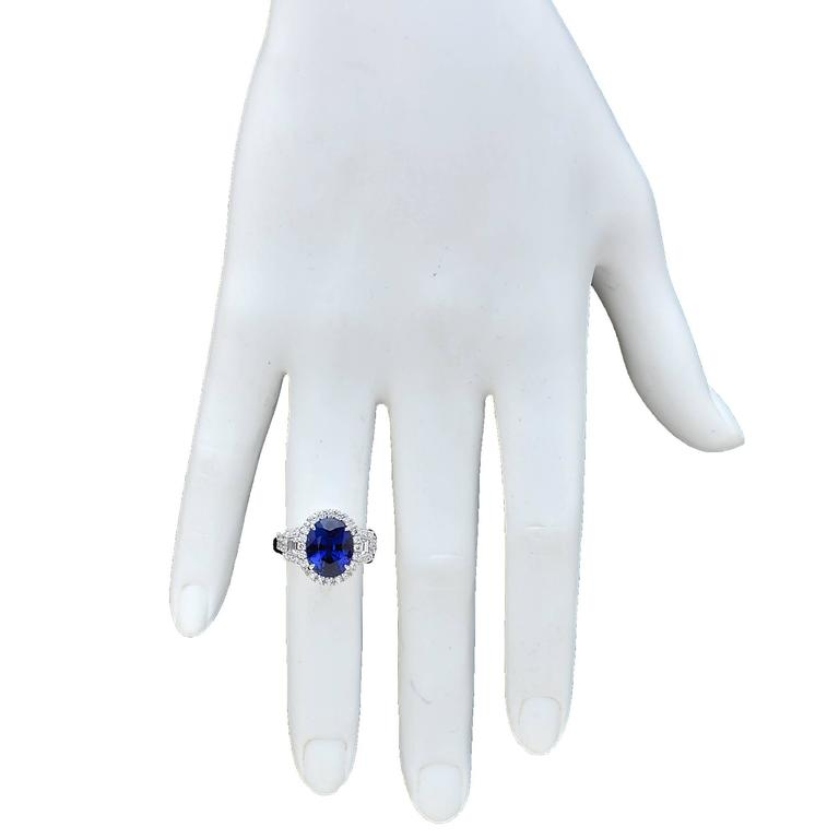 18 Karat White Gold Ring Featuring a 6.22 Carat Natural Blue Sapphire from Madagascar, Heated, AGL Certified, Accented by 1.16 Carats of Trapezoid and Round Brilliant Cut Diamonds, G Color, VS Clarity.