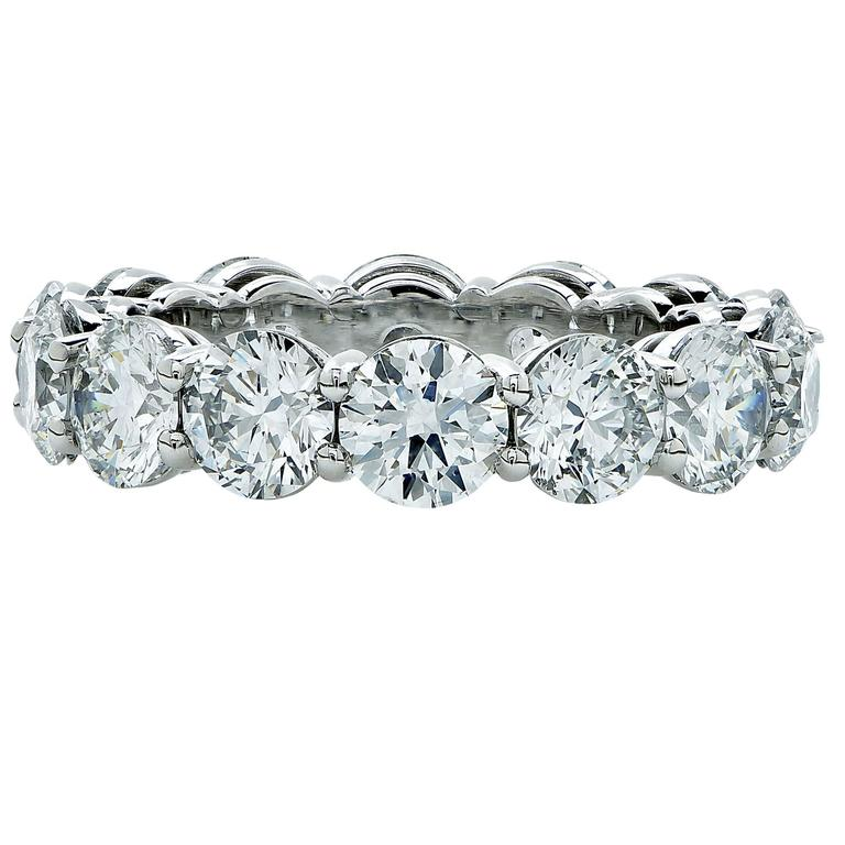 Hand made platinum open gallery shared prong eternity band containing 14 round brilliant cut diamonds weighing 5.62ct D-F color and VS2-SI2 clarity. All diamonds are accompanied by GIA reports.  The ring is a size 6 and can be sized up or