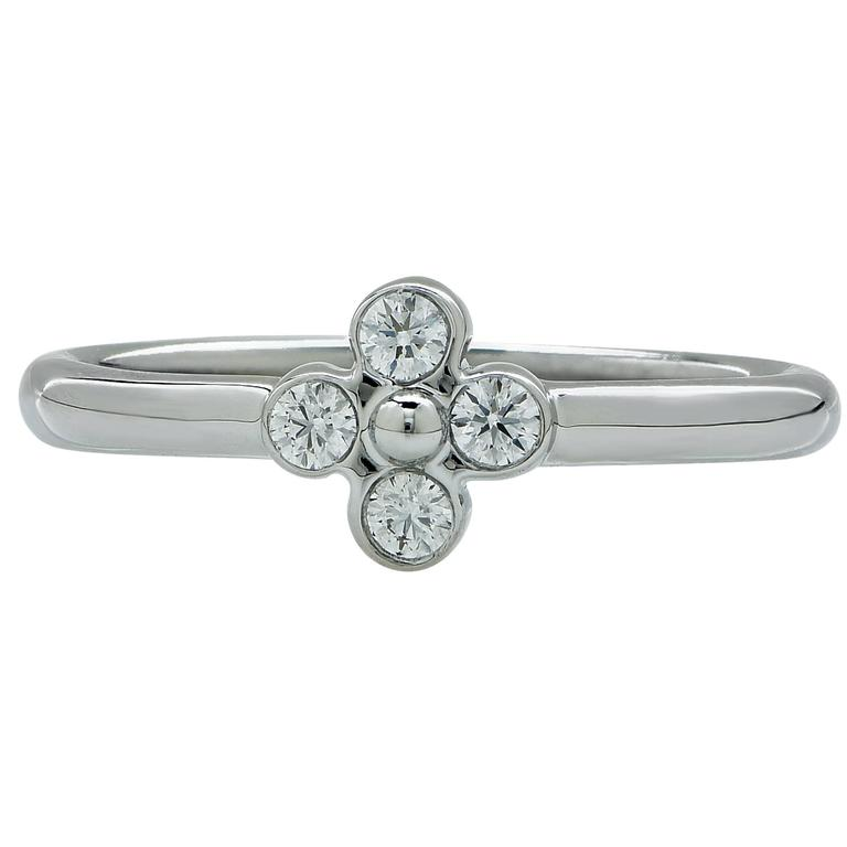 Tiffany & Co. ring featuring 4 round brilliant cut diamonds weighing approximately .05cts total, F color VS clarity.   The ring is a size 5.5 and can be sized up or down. It is stamped and tested as platinum. The metal weight is 3.12