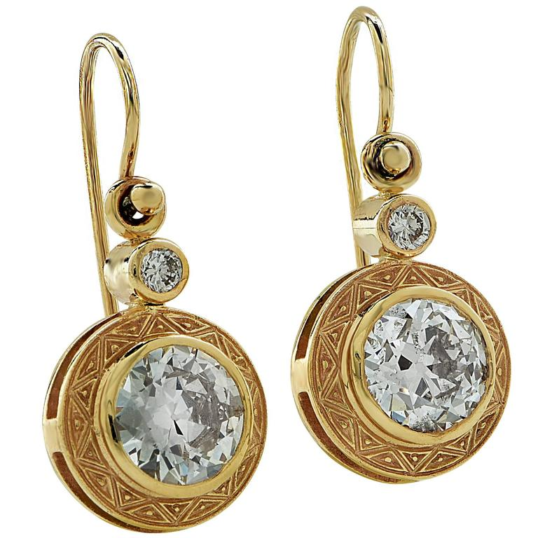 Yellow gold earring containing 2 European cut diamonds weighing approximately 3ct total H-I color and VS2-SI2 clarity accented by 2 round brilliant cut diamonds weighing approximately .15cts.  It is stamped and tested as 18k gold. The metal