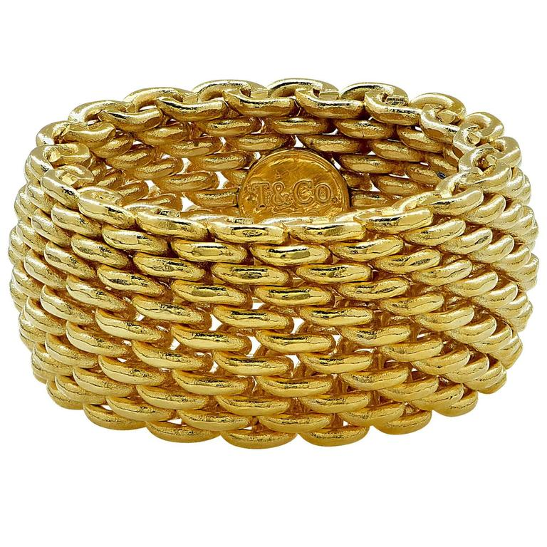 b3060475c 18K yellow gold Tiffany and Company mesh ring. The classical ring is a size  5.5