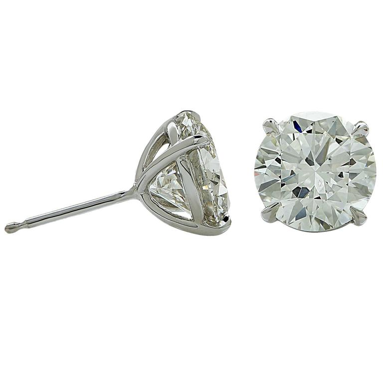 18k white gold earrings featuring a 2.26ct K color Si2 clarity and a 2.14ct K color and SI1 clarity. Both diamonds are accompanied by GIA reports (images attached).