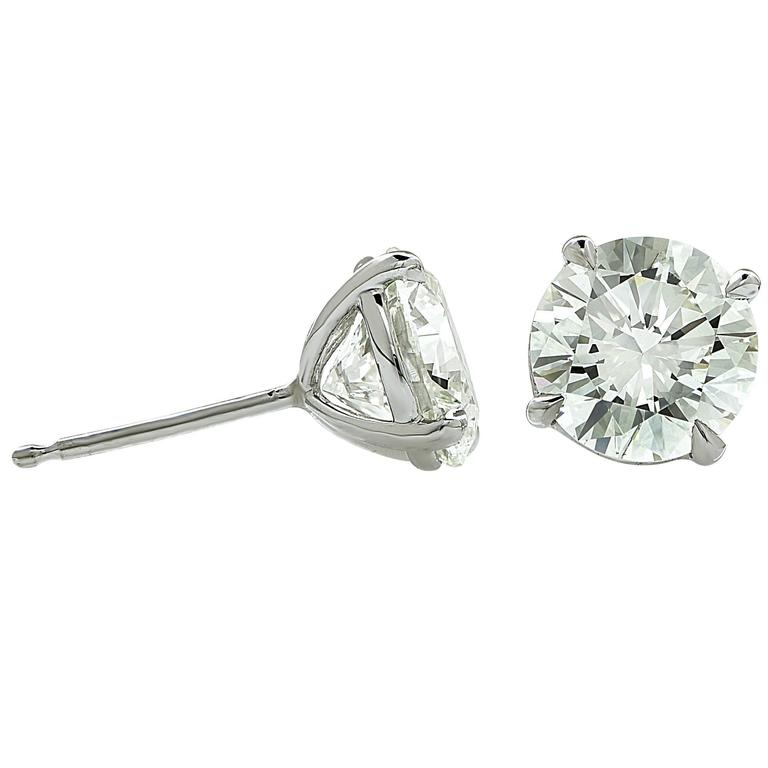 18k white gold earrings containing 2 round brilliant cut diamonds with GIA reports (images attached). The diamonds have a combined total weight of 2.86cts K-L color and VVS clarity.