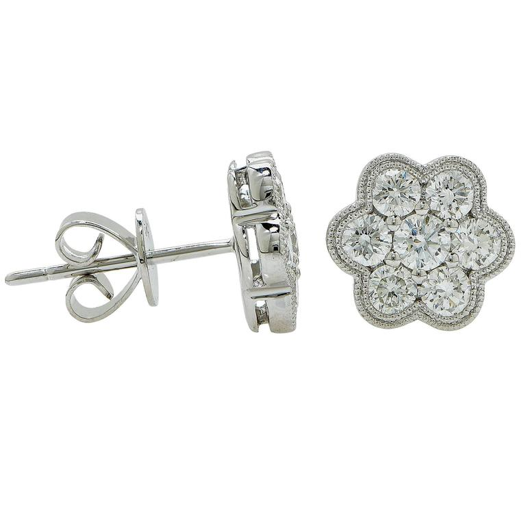 14k white gold cluster earrings featuring 14 round brilliant cut diamonds weighing 1ct total G color VS clarity.