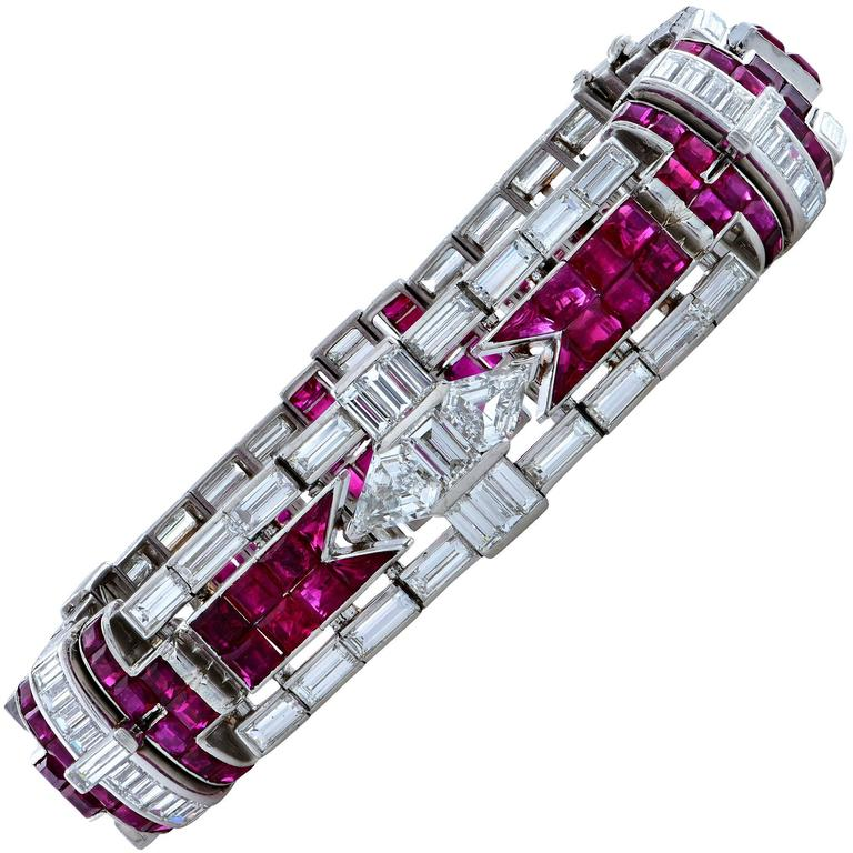 Platinum Art Deco bracelet stamped OCT.31-1922 featuring 96 Custom cut Rubies weighing approximately 22cts, the vast majority being unheated with a Burma origin. There are 94 straight baguette diamonds weighing approximately 18cts D-F color and