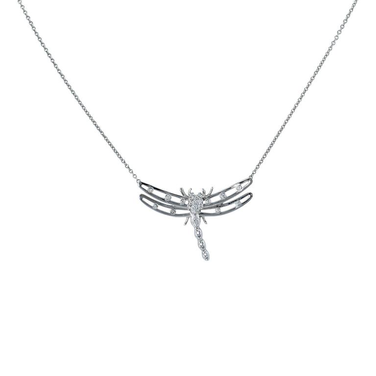 Elegant Tiffany & Co. Diamond Dragonfly Necklace crafted in platinum featuring 25 round brilliant cut diamonds weighing approximately .15cts total.  The chain is 16 inches in length. The pendant is 1.18 inches in width by .76 inch in height. It