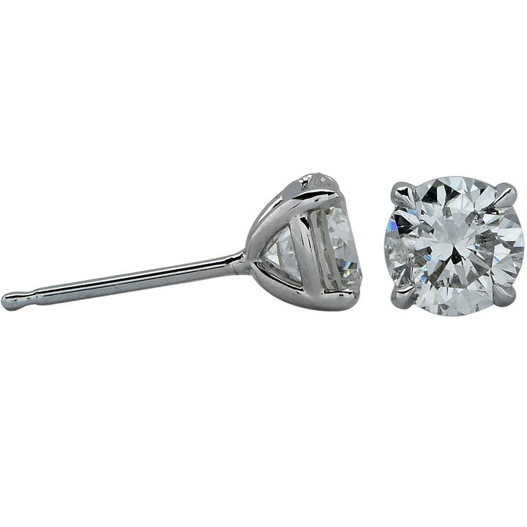 18k white gold 1 carat total weight diamond solitaire stud earrings featuring a matching .53ct round brilliant cut diamond H color and SI in clarity and .47ct round brilliant cut diamond H color and SI in clarity.  Measurements are available upon