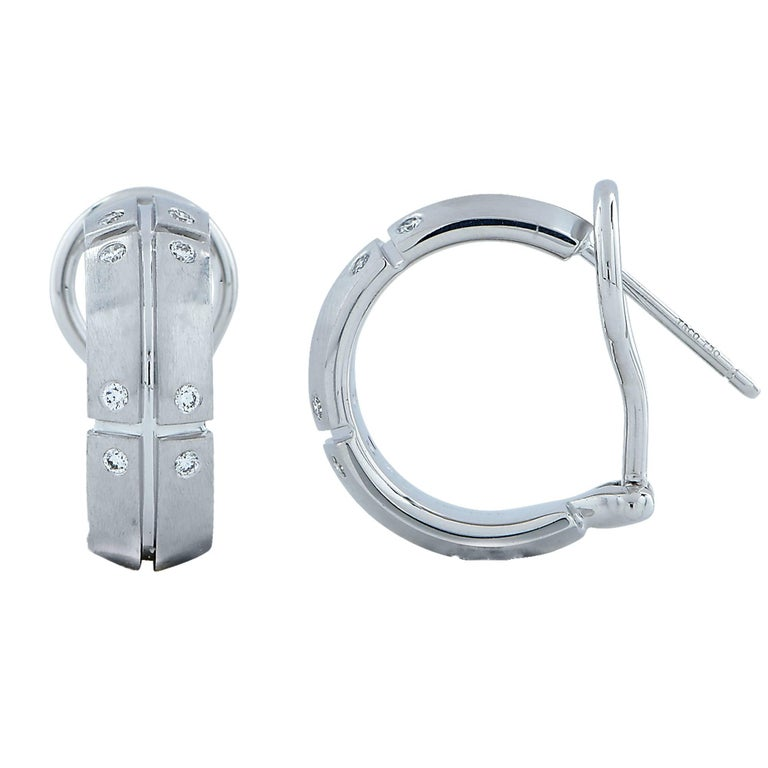 18k white gold Tiffany & Co. hoop lever-back earrings featuring 16 round brilliant cut diamonds weighing .15cts total.  Measurements are available upon request. It is stamped and/or tested as 18k gold. The metal weight is 10.97 grams.  These diamond
