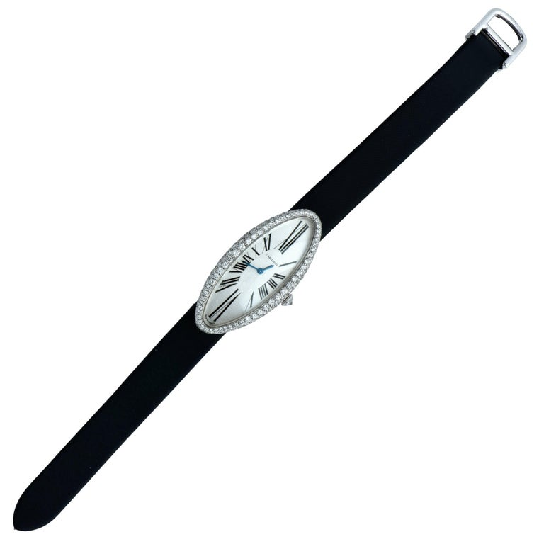 18k white gold ladies Cartier ladies wristwatch with an elongated diamond-set case. From the elegant Baignoire Allongee collection, this watch is sleek and elegant and is the perfect accent to any outfit. Cartier model number 2514. Cal. 060 MC