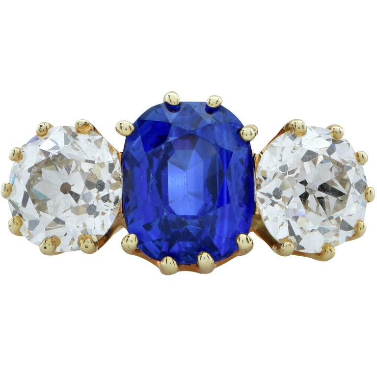 Spectacular sapphire and diamond ring circa 1890 featuring an AGL graded sapphire with a Ceylon provenance and no treatment weighing 5.02cts. The sapphire has a very dreamy and velvety appearance and is accented by two old European cut diamonds