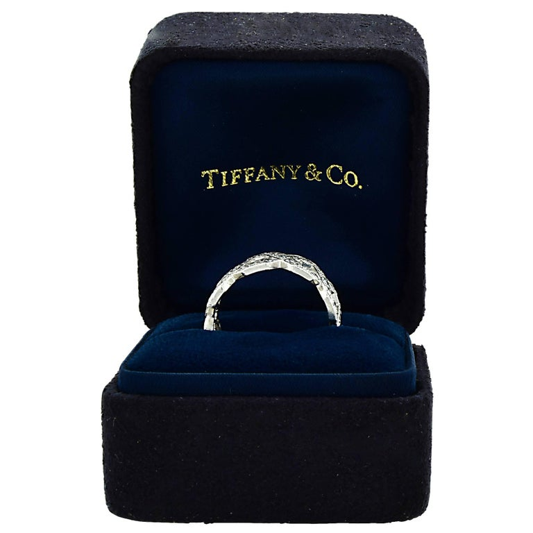 Tiffany & Co. platinum diamond ring containing 56 round brilliant cut diamonds weighing approximately 1.80cts F color and VS clarity.  The ring is a size 5 and can be sized up or down. The ring measures 7.6mm in width. It is stamped and/or tested as