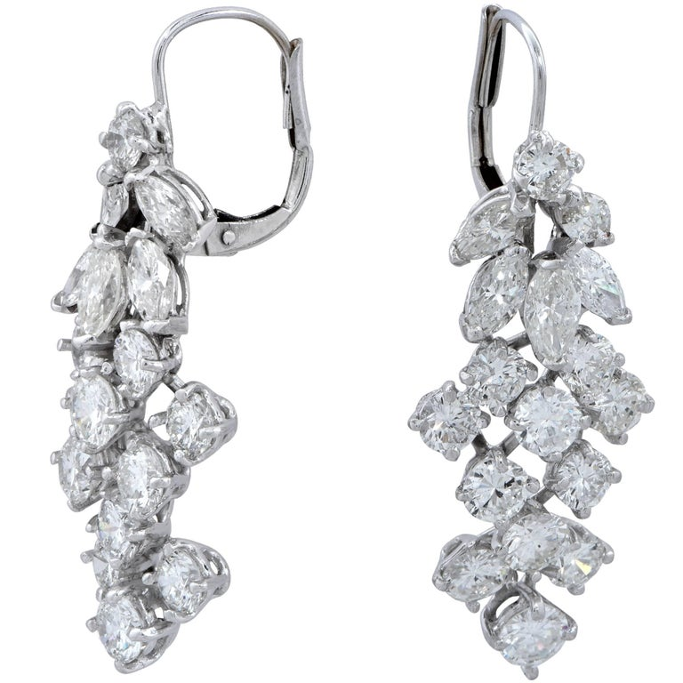 White gold earrings containing 34 round brilliant and marquise cut diamonds weighing approximately 5cts G-I color and VS clarity.  These earrings measure 1.25 inches in length by .50 inch in width. It is stamped and/or tested as 18k gold. The metal
