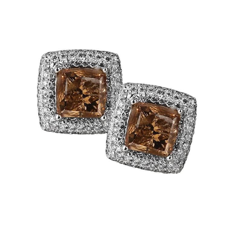 3.79 Carat Fancy Color Diamond Gold Stud Earrings For Sale