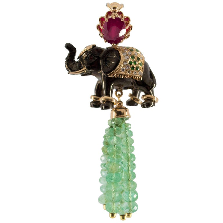 19.90 Carat Emerald 3.10 Carat Ruby Tsavorite Yellow Gold Elephant Pendant For Sale