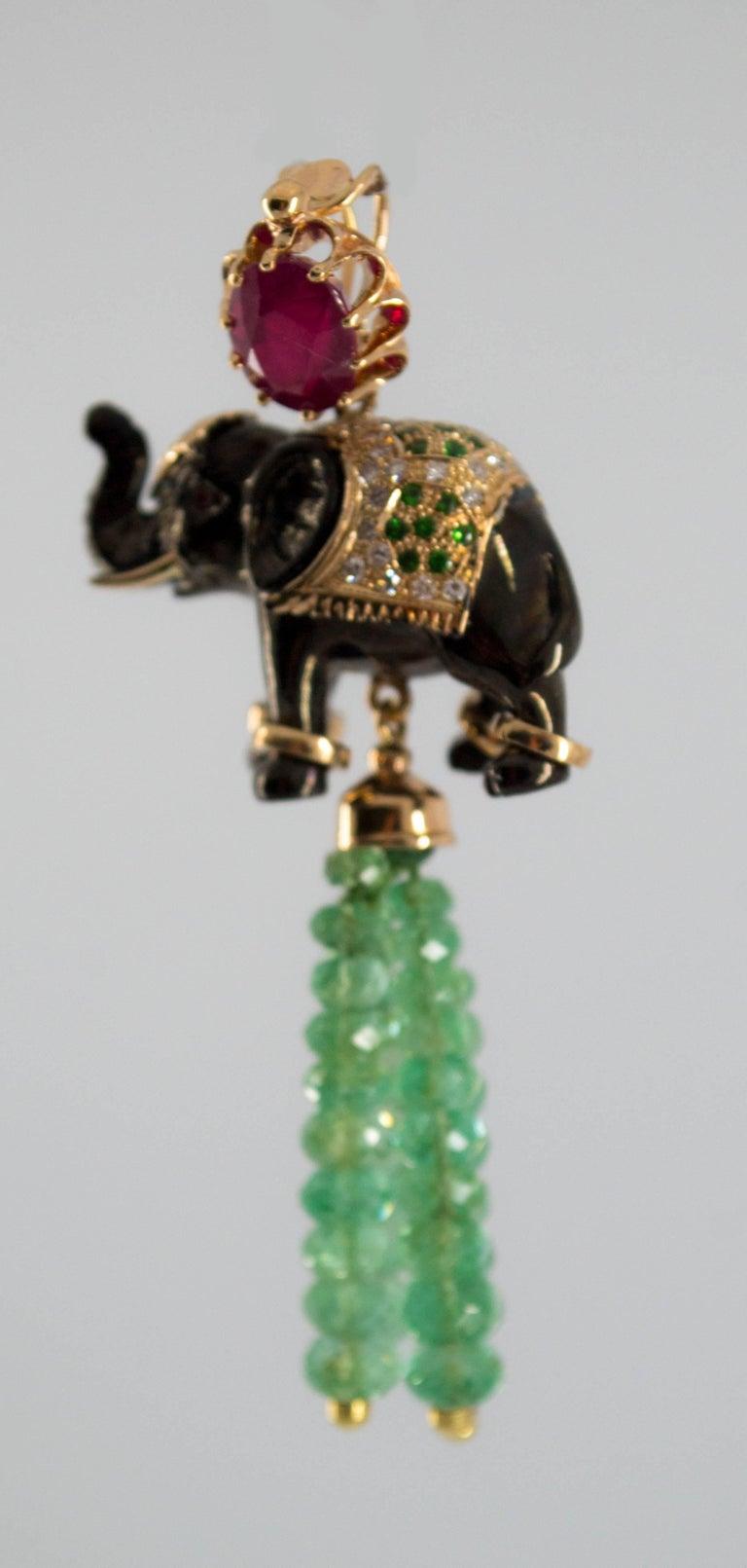 19.90 Carat Emerald 3.10 Carat Ruby Tsavorite Yellow Gold Elephant Pendant For Sale 3