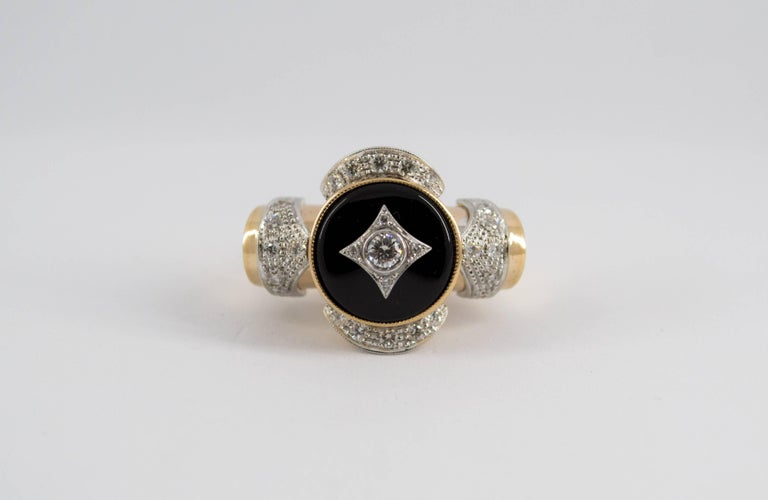 This Ring is made of 14K Yellow Gold. This Ring has 0.75 Carats of Diamonds. This Ring has also Onyx. This Ring is inspired by Renaissance Style. Size ITA: 17 USA: 8 We're a workshop so every piece is handmade, customizable and resizable.