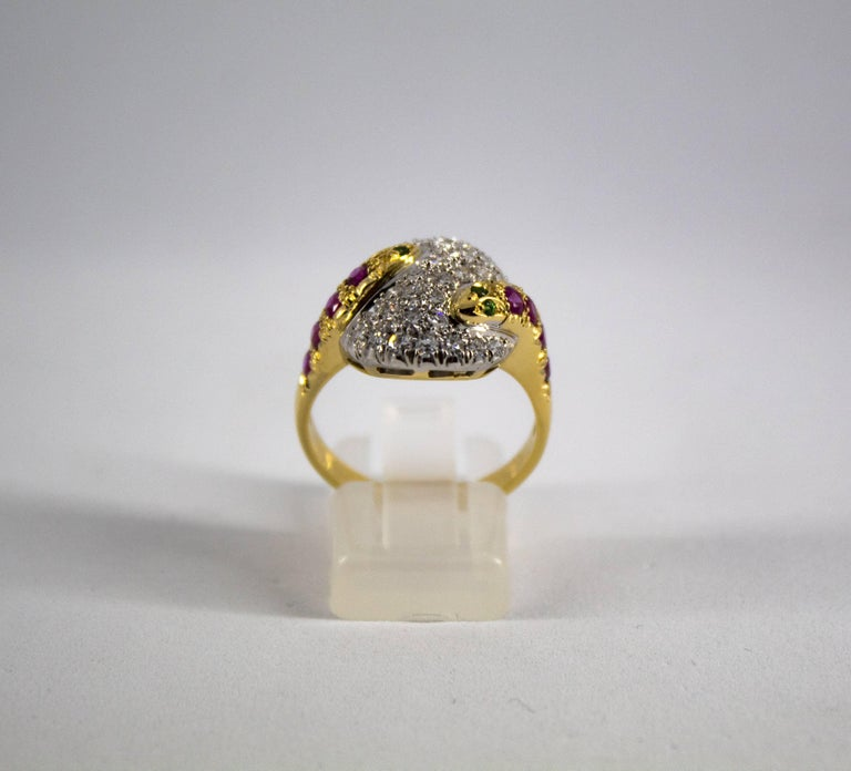 This Ring is made of 18K Yellow Gold. This Ring has 0.90 Carats of White Diamonds. This Ring has 0.40 Carats of Rubies. This Ring has 0.04 Carats of Tsavorite. Size ITA: 17 USA: 8 We're a workshop so every piece is handmade, customizable and