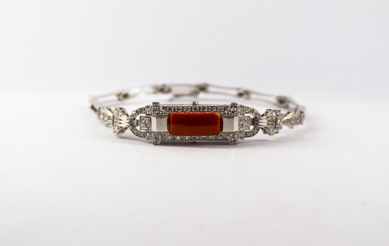 This Bracelet is made of 18K White Gold and Platinum. This Bracelet has 1.03 Carats of White Diamonds. This Bracelet has also Mediterranean (Sardinia, Italy) Red Coral. This Bracelet is inspired by Renaissance Style. We're a workshop so every piece