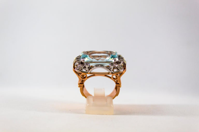 This Ring is made of 18K Yellow and White Gold. This Ring has 0.87 Carats of White Diamonds (Old Cut Diamond). This Ring has a 15.20 Carats Aquamarine. Size ITA: 18 USA: 8 1/4 We're a workshop so every piece is handmade, customizable and resizable.
